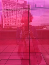 Self-Portrait in Larry Bell's pink cube at the Whitney